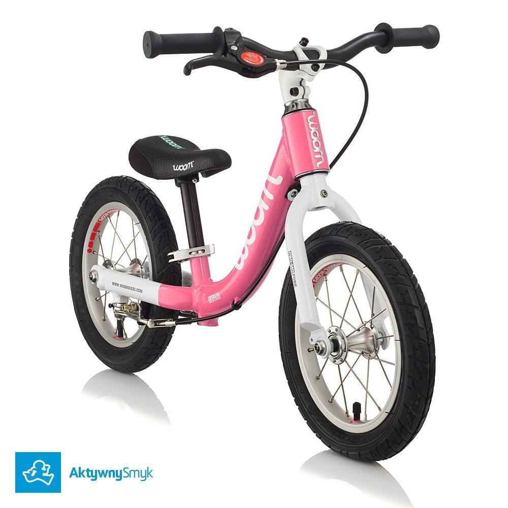 Różowy rowerek biegowy WOOM 1